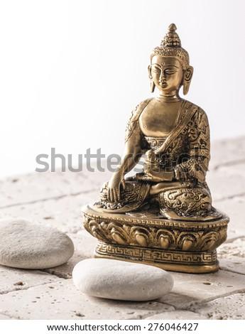 Buddha for zen attitude with stone background - stock photo