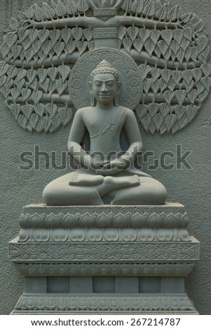 Buddha Image statue made from stone to decorate temple wall in Thailand - stock photo