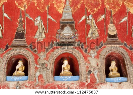 Buddha images in niches at Shwe Yan Phe Pagoda - stock photo