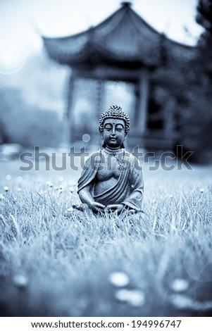 Buddha Meditation in the Garden - stock photo
