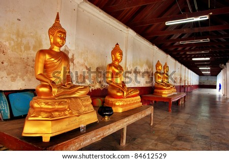 Buddha on table at Wat Phra That Hariphunchai, Lamphun Province, Thailand - stock photo
