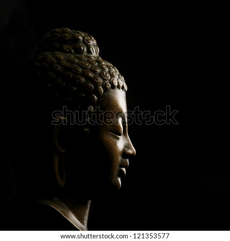 Buddha portrait isolated on black - stock photo