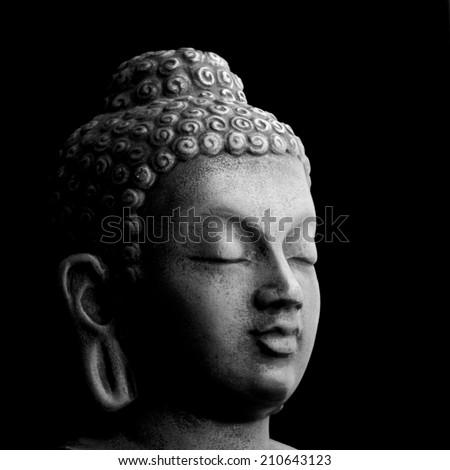 Buddha portrait isolated on black; monochrome - stock photo