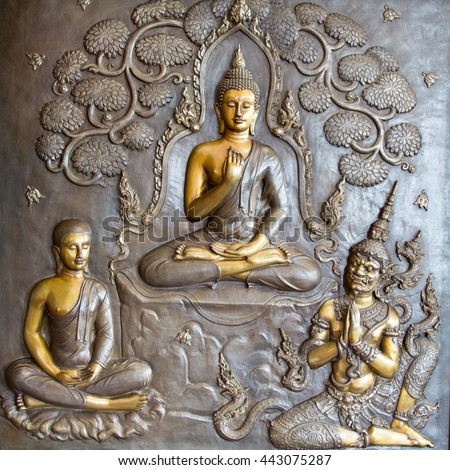 Buddha sculpture image.  Thai style metal carving - stock photo