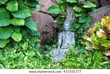Buddha sculpture in zen garden, Maui, Hawaii - stock photo