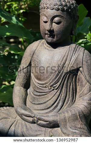 Buddha sitting in lotus position - stock photo