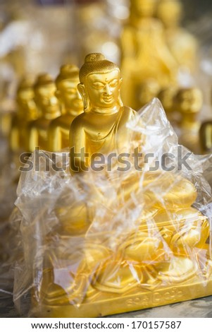 Buddha souvenirs close-up, shallow depth of field, Myanmar, Burma, Southeast Asia - stock photo