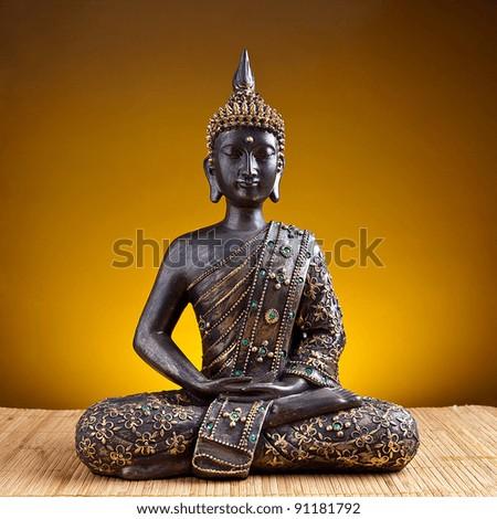 Buddha statue  against golden background - stock photo