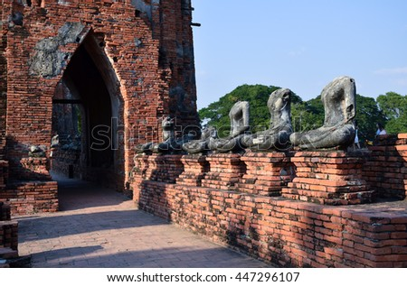 Buddha statue and ancient pagoda in temple, Ayutthaya, central of Thailand, World Heritage,blue sky    - stock photo