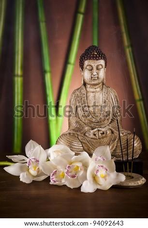Buddha statue and bamboo - stock photo