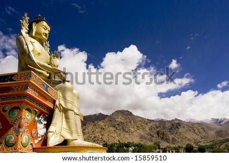 Buddha statue and Himalayas, Ladakh, India - stock photo