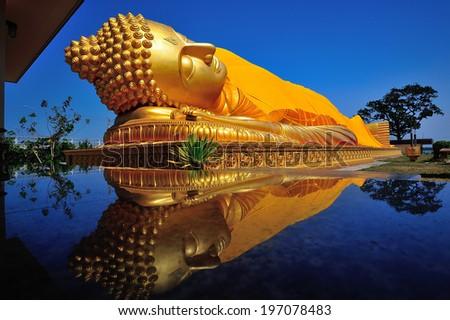 Buddha statue and reflections  - stock photo