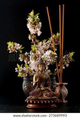 Buddha statue and stones zen. Spa, aromatherapy and meditation - stock photo