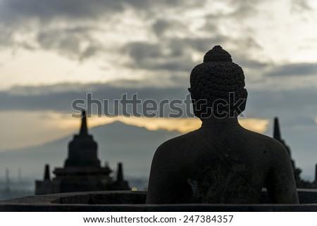 Buddha statue and stupa facing east direction - stock photo