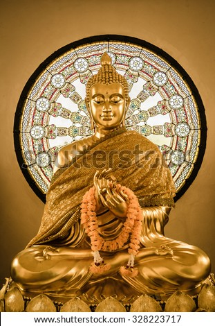 Buddha statue and Wheel of life background made from mosaic - stock photo
