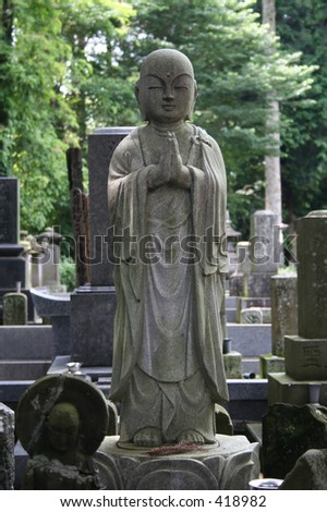 Buddha Statue at a cemetery in the outskirts of Tokyo, Japan - stock photo