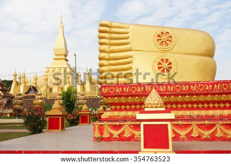 Buddha statue at Wat Pha That Luang, Vientiane, Laos.The are public domain or treasure of Buddhism - stock photo