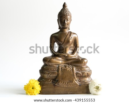 Buddha Statue beside Chrysanthemum Flower - stock photo