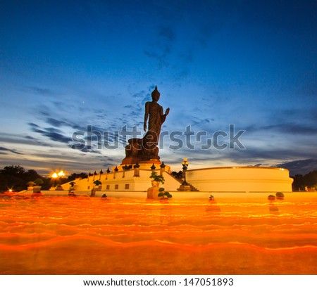 Buddha statue candle lit in lent day thailand - stock photo