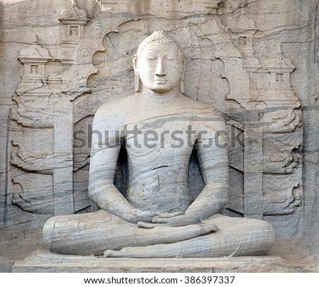 Buddha statue carved in to the rock seated image, Sri Lanka, Ceylon, ancient city of Polonnaruwa, UNESCO World Heritage Site, Gal Vihara - stock photo