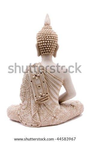 Buddha statue from rear against white background. - stock photo