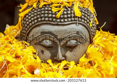 Buddha statue from temple in Thailand - stock photo