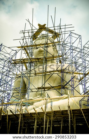 Buddha Statue. Generally in Thailand, any kinds of decorated in Buddhist chuch, etc. they are public domain of Buddhism/ Buddha Statue. under construction /Big buddha statue  (buddha, thai, zen)   - stock photo