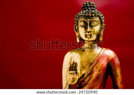 Buddha statue in a meditation position with a zen state of mind - stock photo