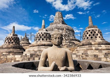 Buddha statue in Borobudur Temple, Java island, Indonesia. - stock photo