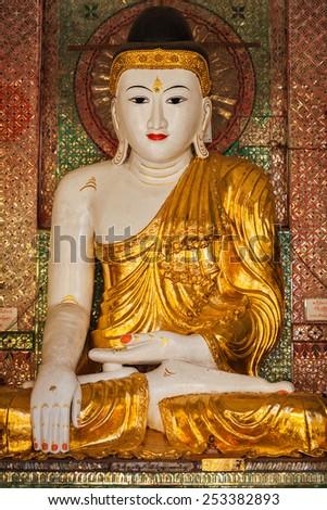Buddha statue in Burma famous sacred place and tourist attraction landmark - Shwedagon Paya pagoda. Yangon, Myanmar - stock photo
