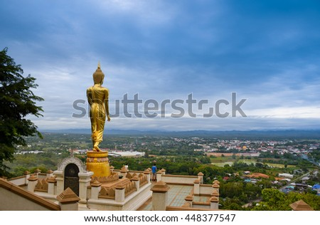 Buddha statue in temple,  Nan, northern of Thailand, cloudy ,  - stock photo