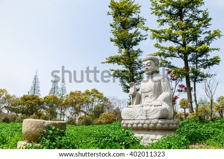 Buddha statue in the temple of Shanghai, China - stock photo