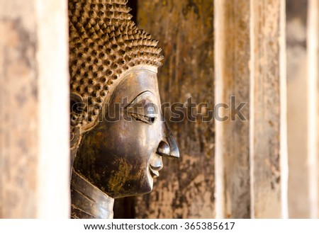 Buddha Statue in Vientiane, Laos. Generally in Laos, any kinds of decorated in Buddhist church, etc. they are public domain of Buddhism - stock photo