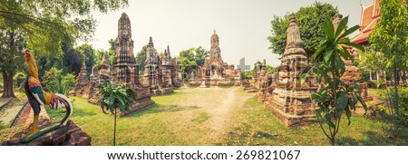 Buddha statue in Wat Cherng Tha. Ayutthaya historical park. Panorama - stock photo