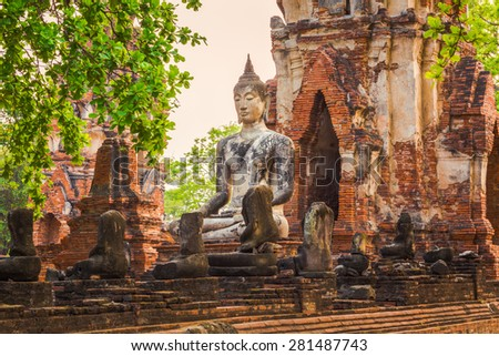 Buddha statue in Wat Mahathat. Ayutthaya historical park.  - stock photo