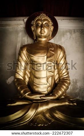 Buddha statue in Wat Phra That Hariphunchai temple , Thailand - stock photo