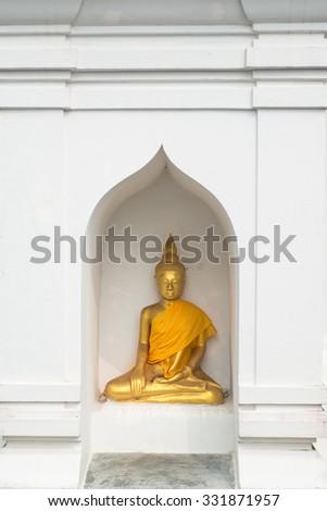 Buddha statue in white pagoda - stock photo