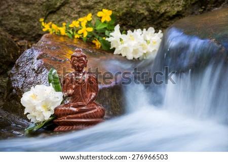 Buddha statue on a creek - stock photo