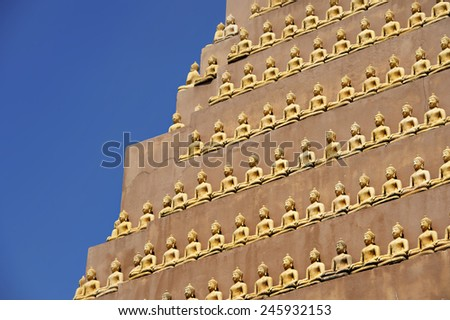 buddha statue on big stupa - stock photo