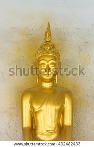 Buddha statue on white wall  - stock photo