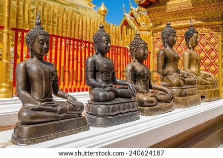 Buddha statues at Wat Phra That Doi Suthep the most popular temple in Chiang Mai, Thailand - stock photo