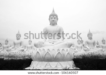 Buddha statues image in black and white - stock photo