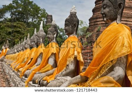 "Buddha statues in a row at ""Wat Yai-Chaimongkol"" Buddhist temple in Ayutthaya - Thailand - stock photo"