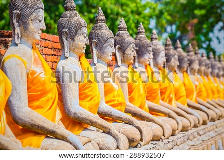 Buddha statues in Ayutthaya,Thailand. In 1767, the city was destroyed by the Burmese army. The ruins are preserved in Ayutthaya historical park, which is recognized as a UNESCO World Heritage Sit - stock photo