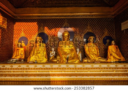 Buddha statues in Burma famous sacred place and tourist attraction landmark - Shwedagon Paya pagoda. Yangon, Myanmar - stock photo