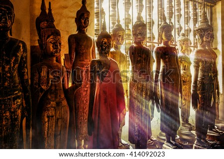 Buddha statues in Wat Phra That Mak Mo in Luang Prabang , Laos ,South East Asia - stock photo