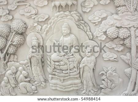 Buddha teaching in stone sculpture - stock photo