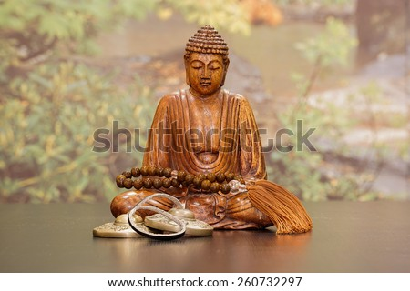 Buddha with Meditation Chimes and Beads - stock photo