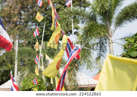 Buddhism flag and Thai flag in Buddhist Temple - stock photo