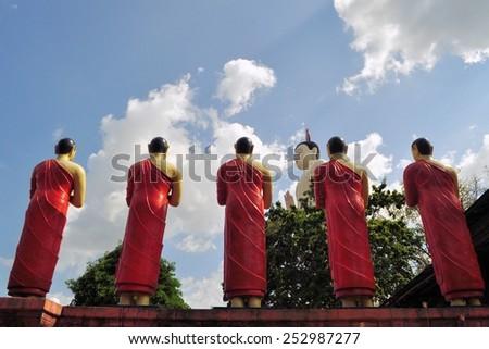 Buddhist Disciple statues at a temple in Sri Lanka - stock photo